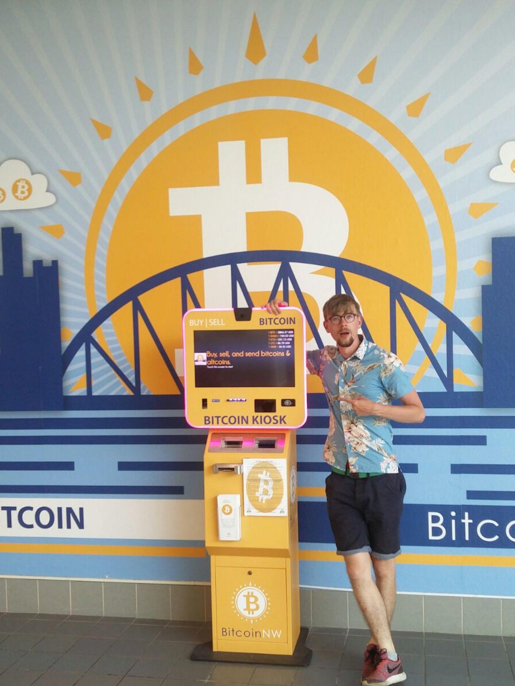 Thomas next to the Bitcoin ATM