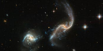 Arp 256 is a stunning system of two spiral galaxies, about 350 million light-years away, in an early stage of merging.