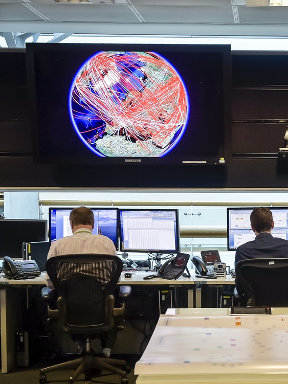 CHELTENHAM, ENGLAND - NOVEMBER 17: A general view of the 24 hour Operations Room inside GCHQ, which Chancellor of the Exchequer George Osborne was shown by of Director of GCHQ Robert Hannigan and Cheltenham MP Alex Chalk on November 17, 2015 in Cheltenham, England. Chancellor George Osborne delivered a speech in which he stated that Britain has developed an 'offensive cyber capability' to hit back directly at terrorists and states, as he warned Islamic State was seeking to launch potentially deadly attacks on UK targets. (Photo by Ben Birchall - WPA Pool / Getty Images)