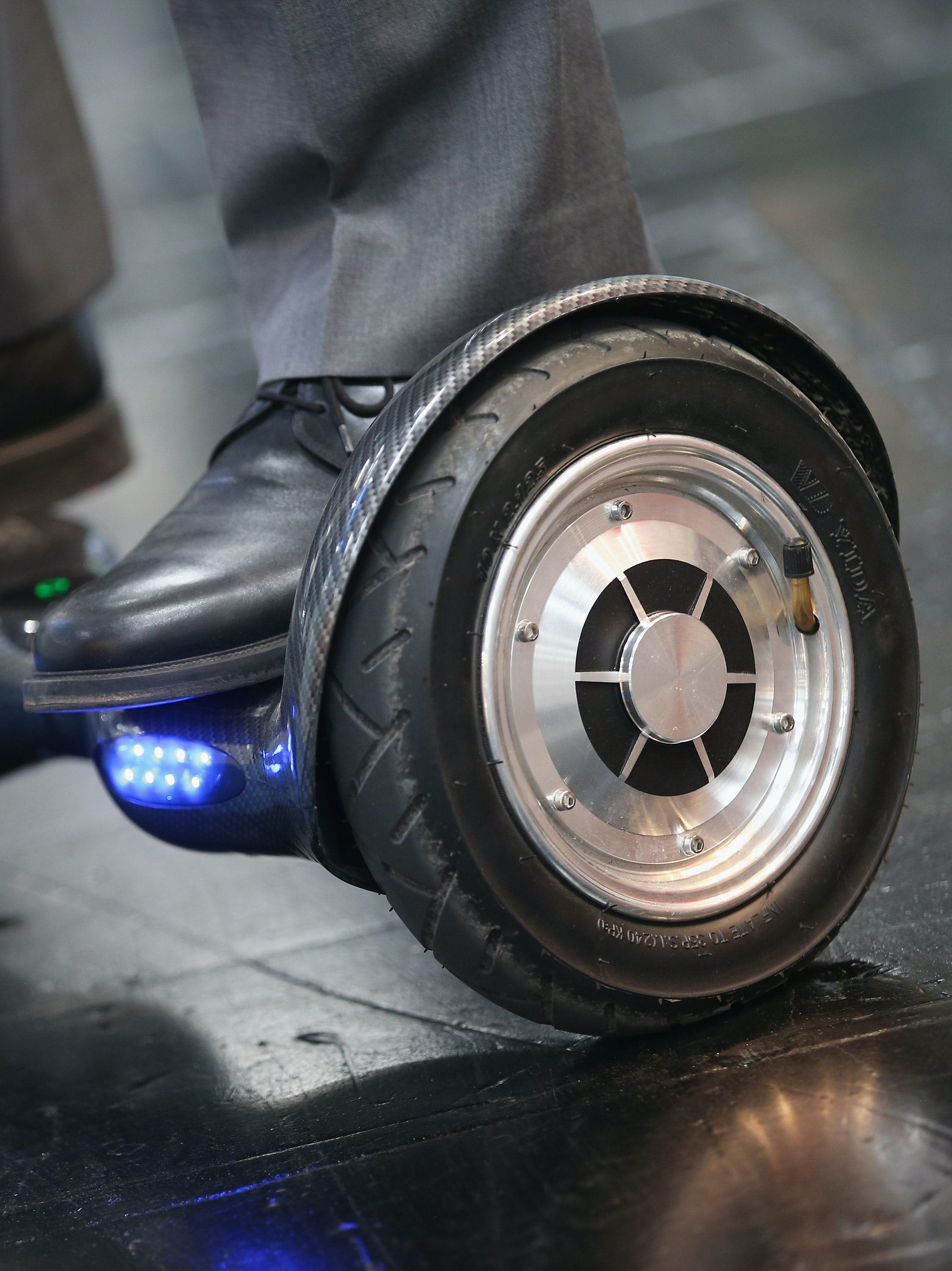 HANOVER, GERMANY - MARCH 14:  A host rides a BykeBoard hoverboard at the 2016 CeBIT digital technology trade fair on the fair's opening day on March 14, 2016 in Hanover, Germany. The 2016 CeBIT will run from March 14-18.  (Photo by Sean Gallup/Getty Images)