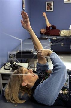 Joan Malchow and husband Doug Malchow hold up their arms after giving blood for the Red Cross, Friday, Dec. 21, 2007, in Princeton, New Jersey.