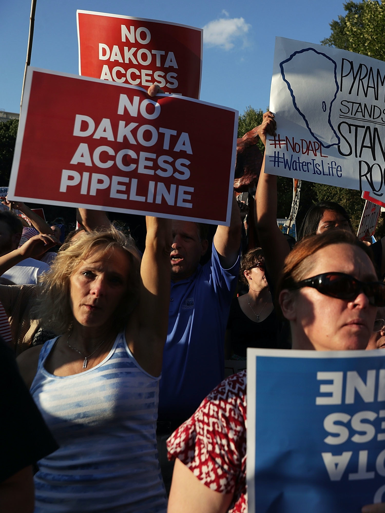 WASHINGTON, DC - SEPTEMBER 13:  Activists gather in front of the White House during a rally against the Dakota Access Pipeline September 13, 2016 in Washington, DC. Activists held a rally to call on President Barack Obama to stop the Dakota Access Pipeline.  (Photo by Alex Wong/Getty Images)