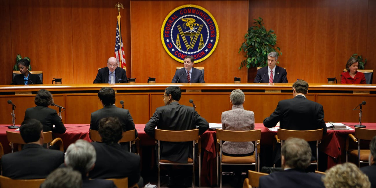WASHINGTON, DC - DECEMBER 21: Federal Communications Commission Commissioners (L-R) Mignon Clyburn, Michael Copps, Chairman Julius Genachowski, Robert McDowell and Meredith Attwell Baker deliver opening remarks before they voted 3-2 to adopted controversial Net neutrality rules December 21, 2010 in Washington, DC. The rules put into effect by the commission create two different classes of broadband internet service -- one for fixed networks and another for wireless networks -- due to their technological differences. (Photo by Chip Somodevilla/Getty Images)