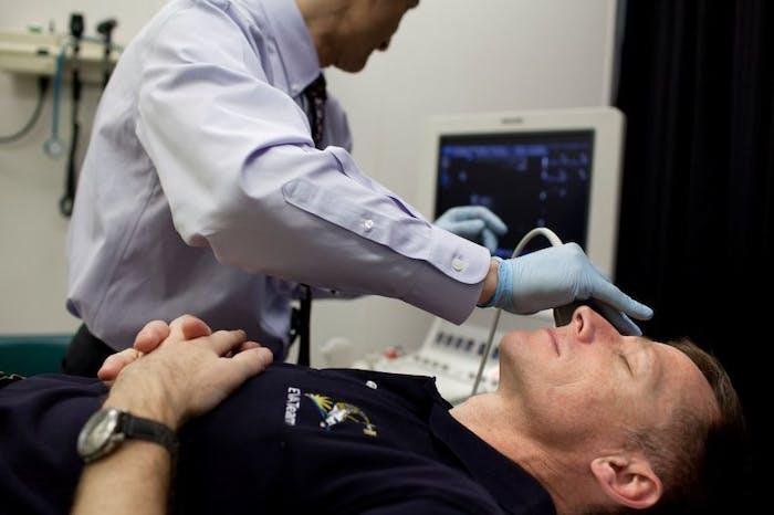 NASA astronaut Chris Ferguson has an eye examination at the Johnson Space Center.