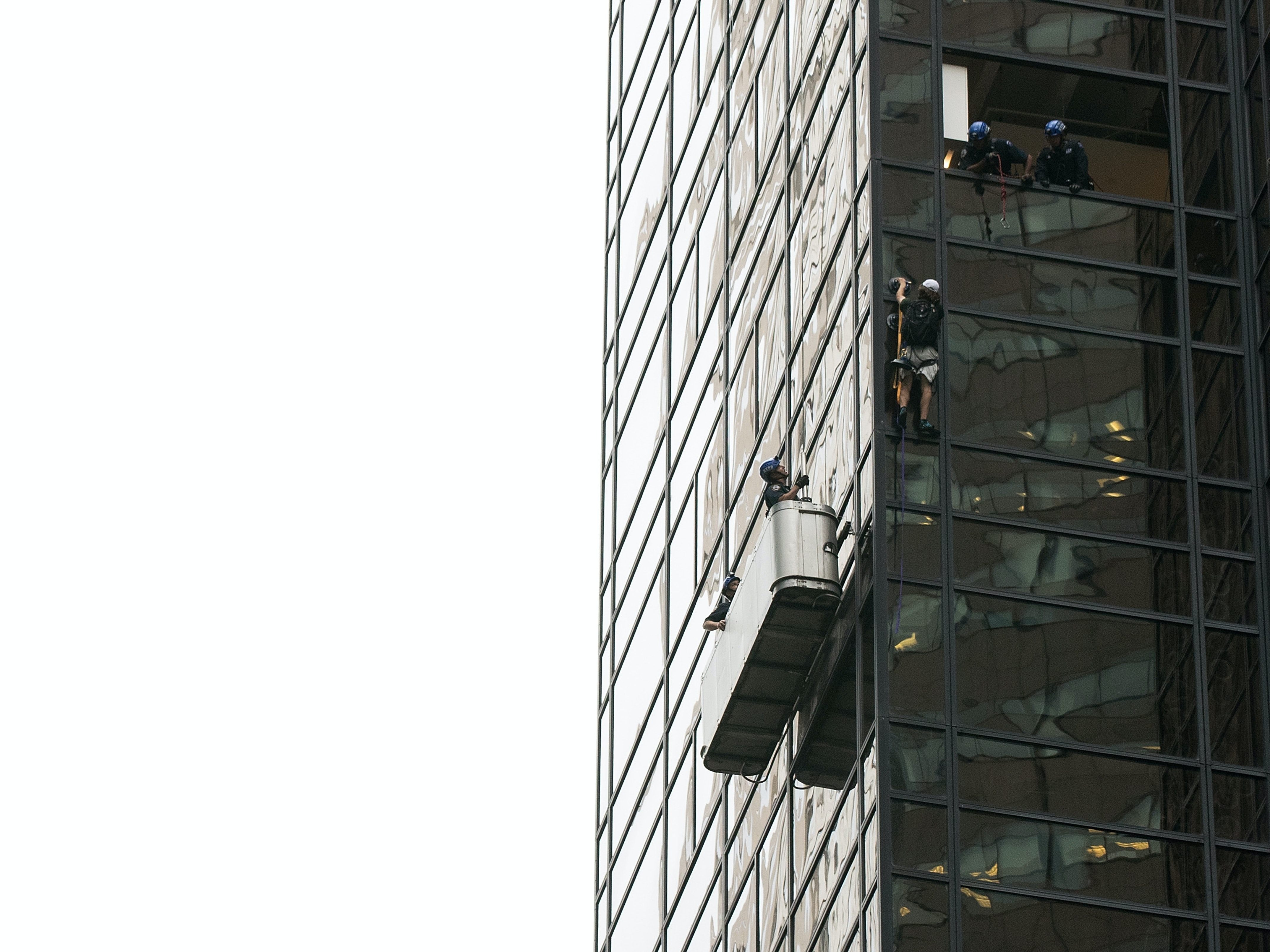 NEW YORK, NY - AUGUST 10: A man identified as 'Steve from Virginia' climbs up the Trump Tower on August 10, 2016 in New York City. The man used suction cups to scale more than 20 stories of GOP Presidential Candidate Donald Trump's signature skyscraper in Manhattan. (Photo by Drew Angerer/Getty Images)