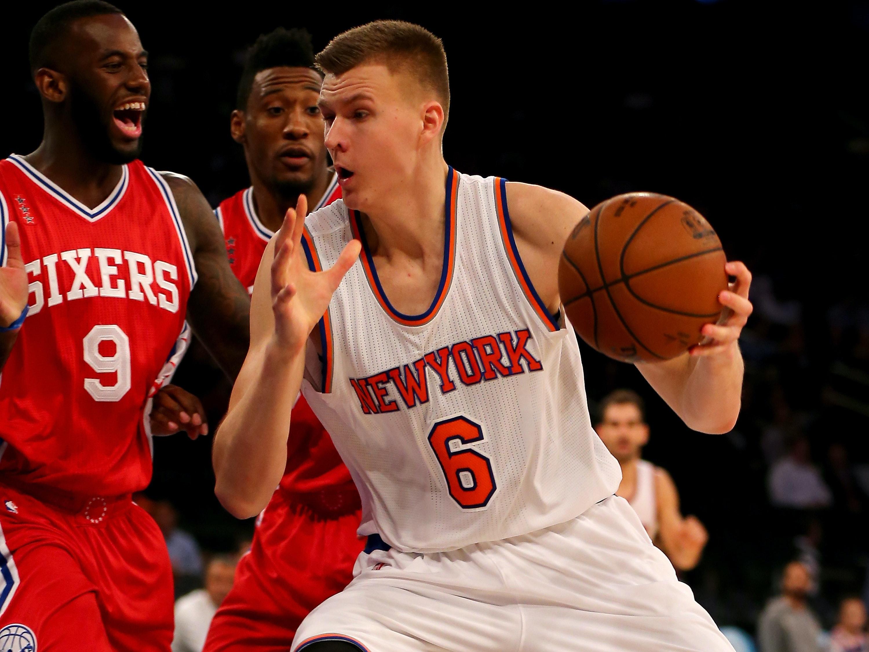 NEW YORK, NY - DECEMBER 02:  Kristaps Porzingis #6 of the New York Knicks heads for the net as JaKarr Sampson #9 of the Philadelphia 76ers