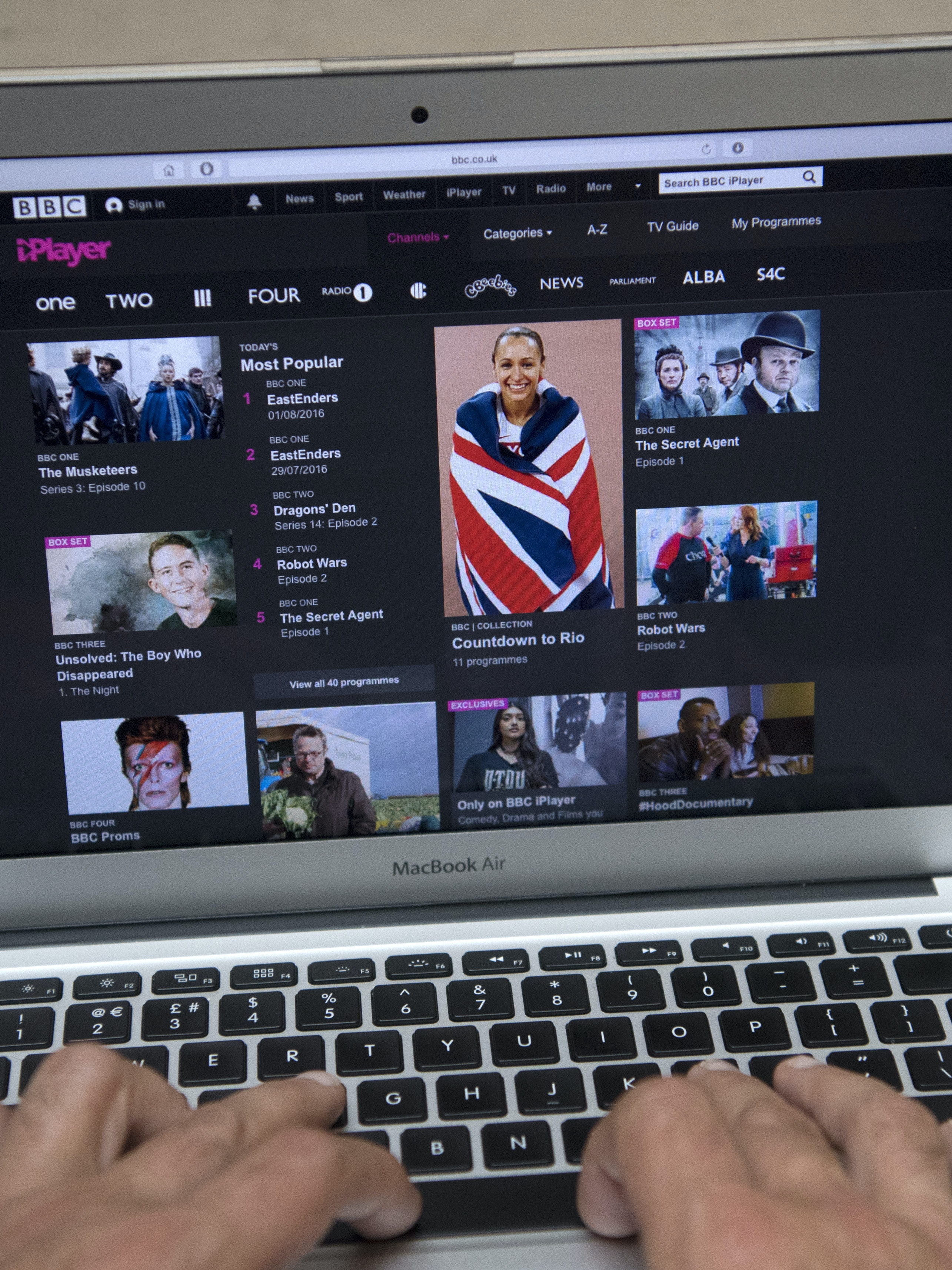 LONDON, ENGLAND - AUGUST 02:  In this photo illustration, the BBC iPlayer app is displayed on a laptop screen as hands touch its keyboard on August 2, 2016 in London, England. The BBC has announced that iPlayer users will have to pay a 145GBP TV licence fee from 1 September.  (Photo Illustration by Carl Court/Getty Images)