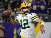 p.p1 {margin: 0.0px 0.0px 0.0px 0.0px; font: 18.0px Georgia}    Green Bay Packers Quarterback Aaron Rodgers (12) makes a throw during an NFL game between the Minnesota Vikings and Green Bay Packers on November 25, 2018 at U.S. Bank Stadium in Minneapolis, Minnesota. The Vikings defeated the Packers 24-17.
