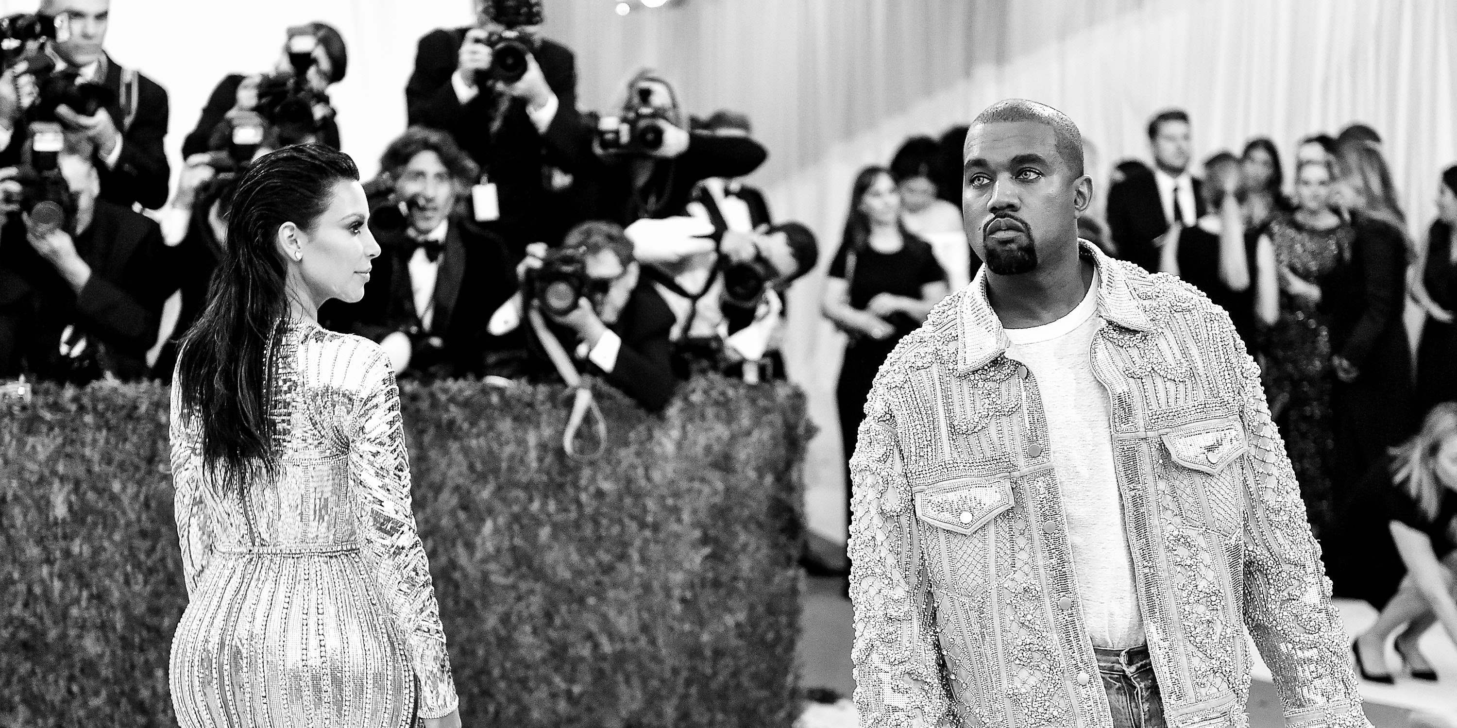 NEW YORK, NY - MAY 02:  (EDITORS NOTE: Image has been converted to black and white.) Kim Kardashian (L) and Kanye West attend the 'Manus x Machina: Fashion In An Age Of Technology' Costume Institute Gala at Metropolitan Museum of Art on May 2, 2016 in New York City.  (Photo by Mike Coppola/Getty Images for People.com)