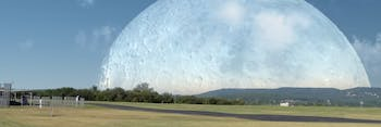 Still of a video depicting how the moon would look if it was as close to Earth as the ISS.