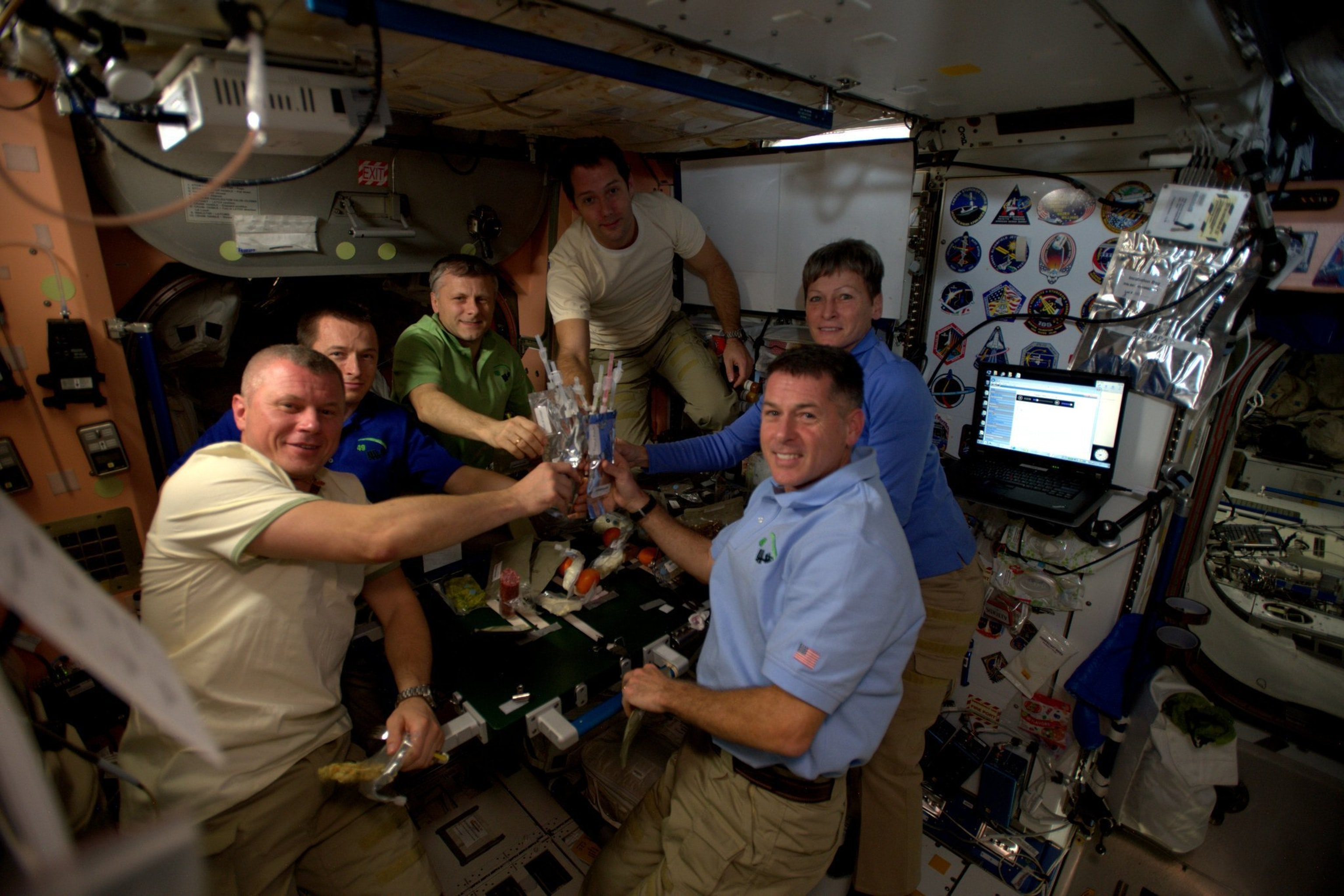 The six expedition 50 crew members celebrate Thanksgiving in space.