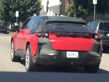 Watch a Disguised Faraday Future Prototype Stalking a Tesla Model X