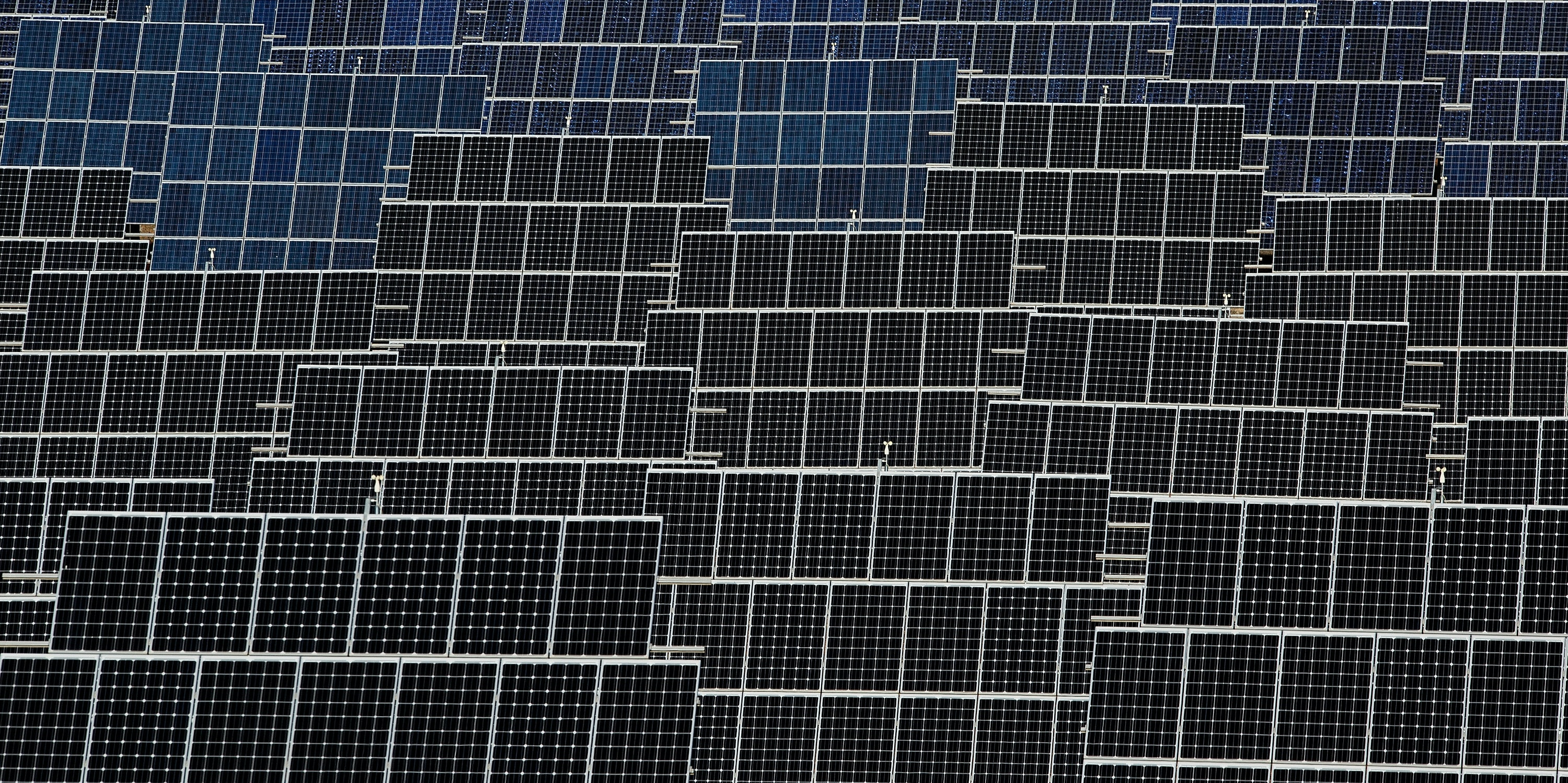 Photovoltaic power panels stand at Abaste's El Bonillo Solar Plant.