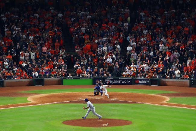 HOUSTON, TX - OCTOBER 30: Alex Bregman #2 of the Houston Astros hits a game-winning single during the tenth inning against Kenley Jansen #74 of the Los Angeles Dodgers in game five of the 2017 World Series at Minute Maid Park on October 30, 2017 in Houston, Texas. (Photo by Ezra Shaw/Getty Images)