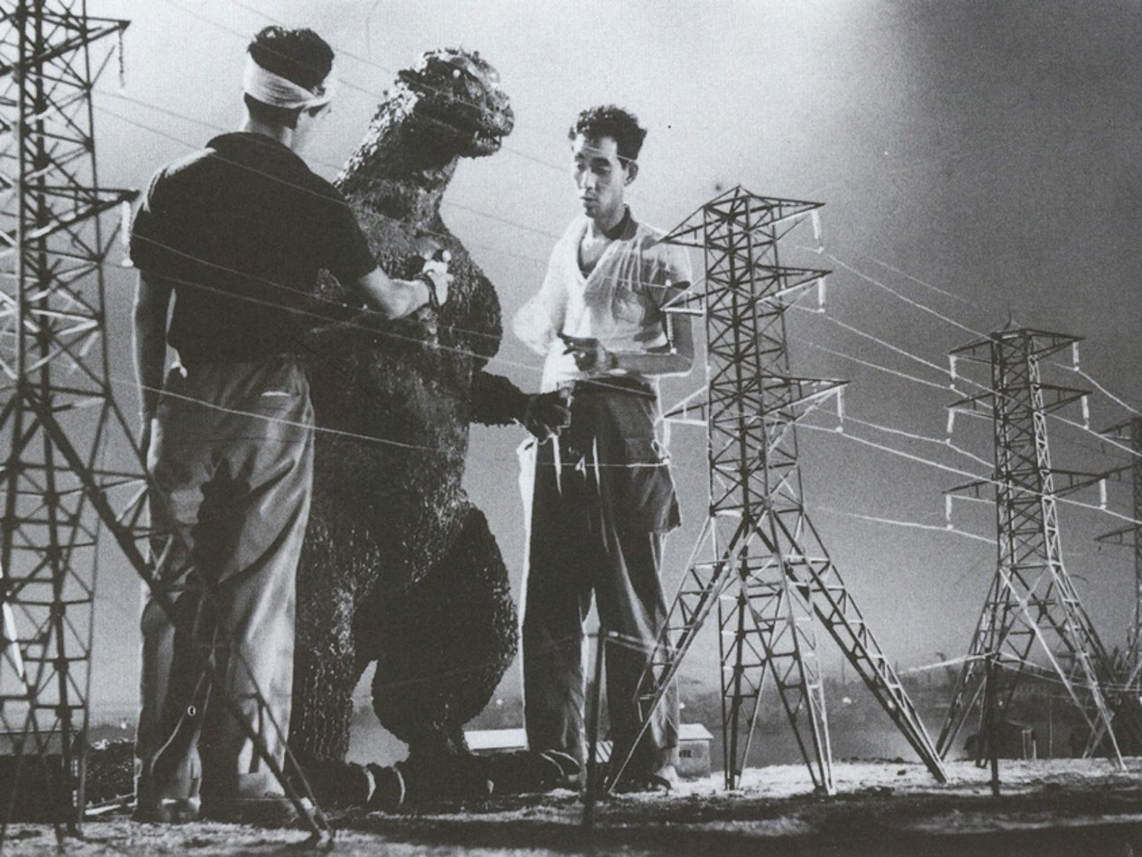 The classic Godzilla filming technique was to use a 'full-size' man-in-suit performer and miniaturized buildings or locations, such as these steel transmission towers.