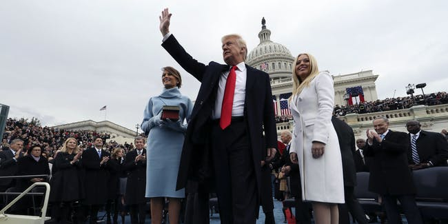 WASHINGTON, DC - JANUARY 20:  U.S. President Donald Trump acknowledges the audience after taking the oath of office as his wife Melania (L) and daughter Tiffany watch during inauguration ceremonies swearing in Trump as the 45th president of the United States on the West front of the U.S. Capitol in Washington, DC. January 20, 2017. (Photo by Jim Bourg - Pool/Getty Images)