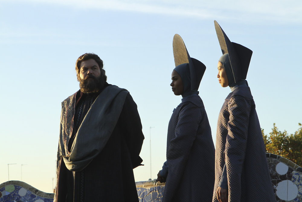 Vincent D'Onofrio as The Wizard and his attendants in silly hats