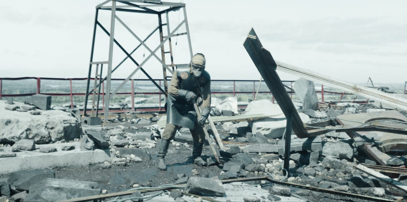 "A ""biorobot""-- a man in protective gear -- on the roof of the Chernobyl Nuclear Power Station, as depicted in the HBO series."