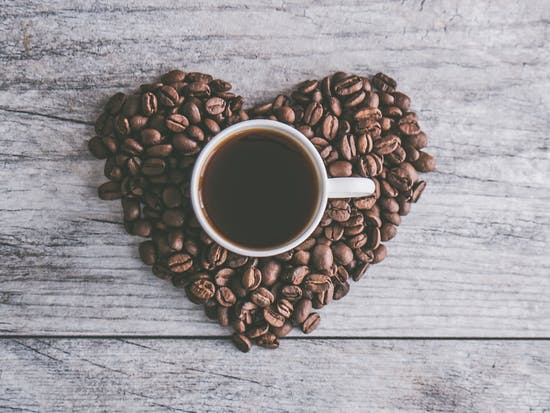 White Ceramic Mug Filled With Brown Liquid on Heart-shaped Coffee Beans - Credit to https://toolstotal.com/