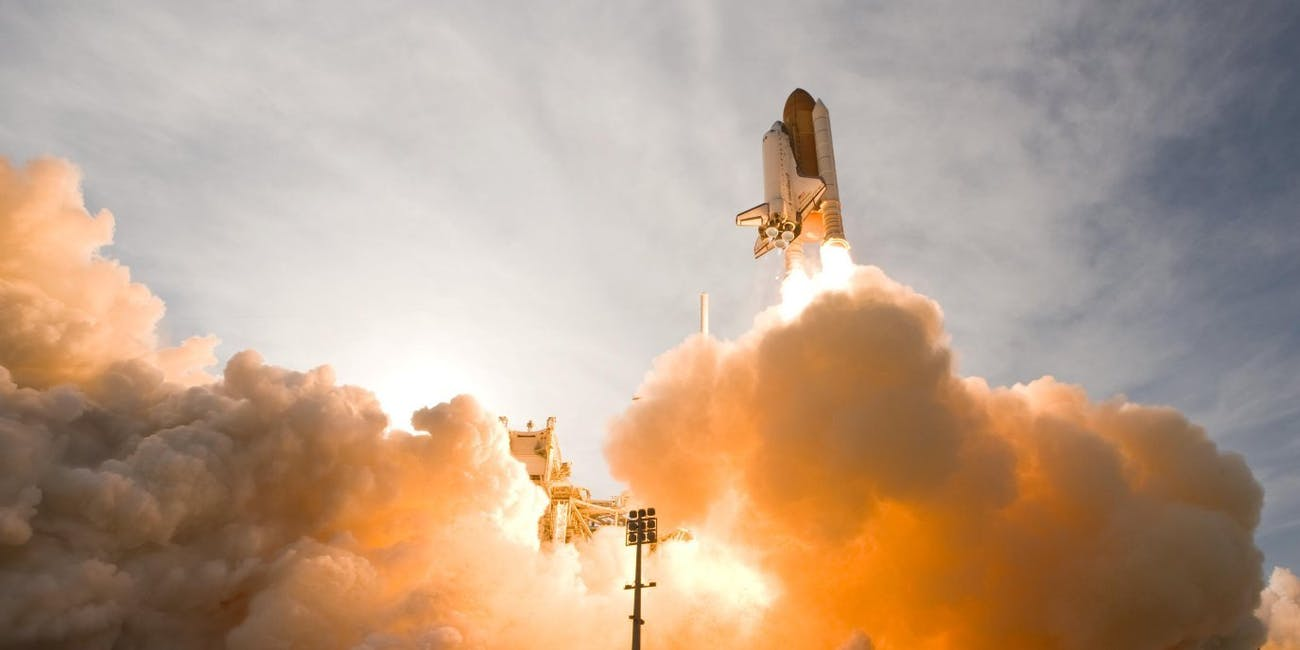 NASA space shuttle lifting off.