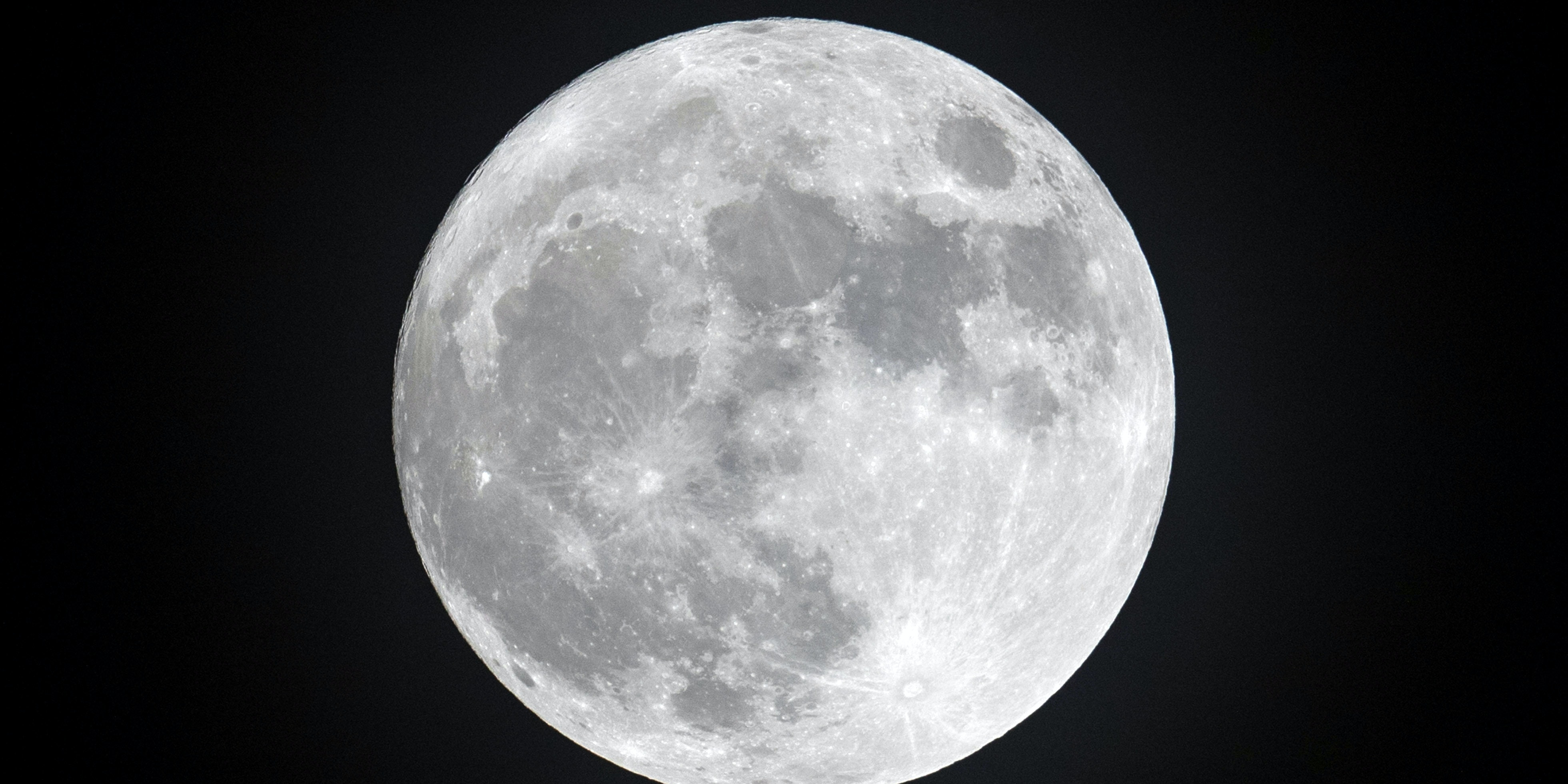Clouds clear to allow a view of the final full moon of the year, a so-called 'Cold Moon', as it appears behind lights illuminating Penzance seafront on December 13, 2016 in Cornwall, England. The last full moon of the year was also the final supermoon of 2016. The natural phenomenon occurs when the perigee (closest approach by the Moon to Earth) coincides with it being full (completely illuminated by the Sun).