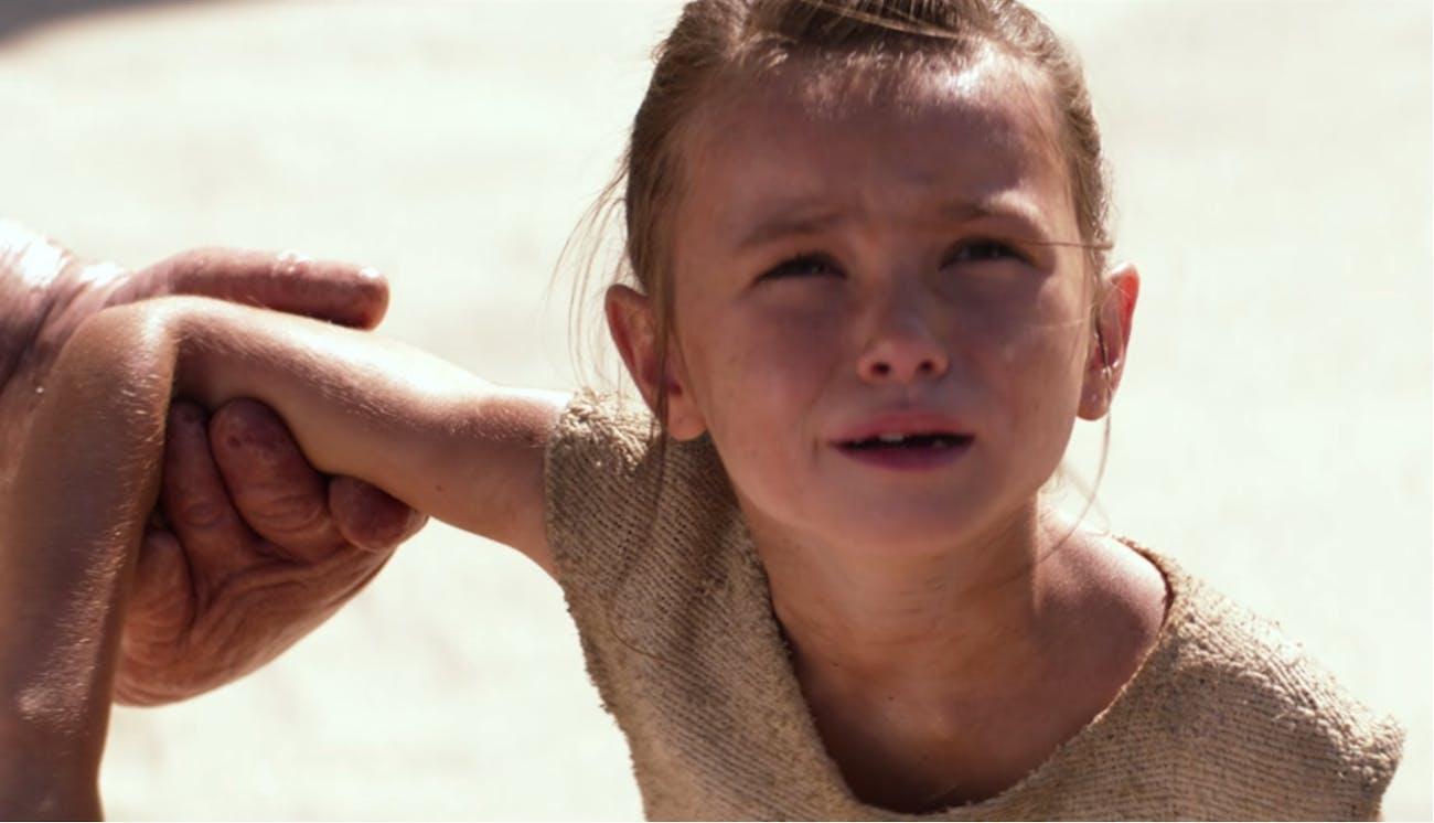 Young Rey gets abandoned on Jakku.