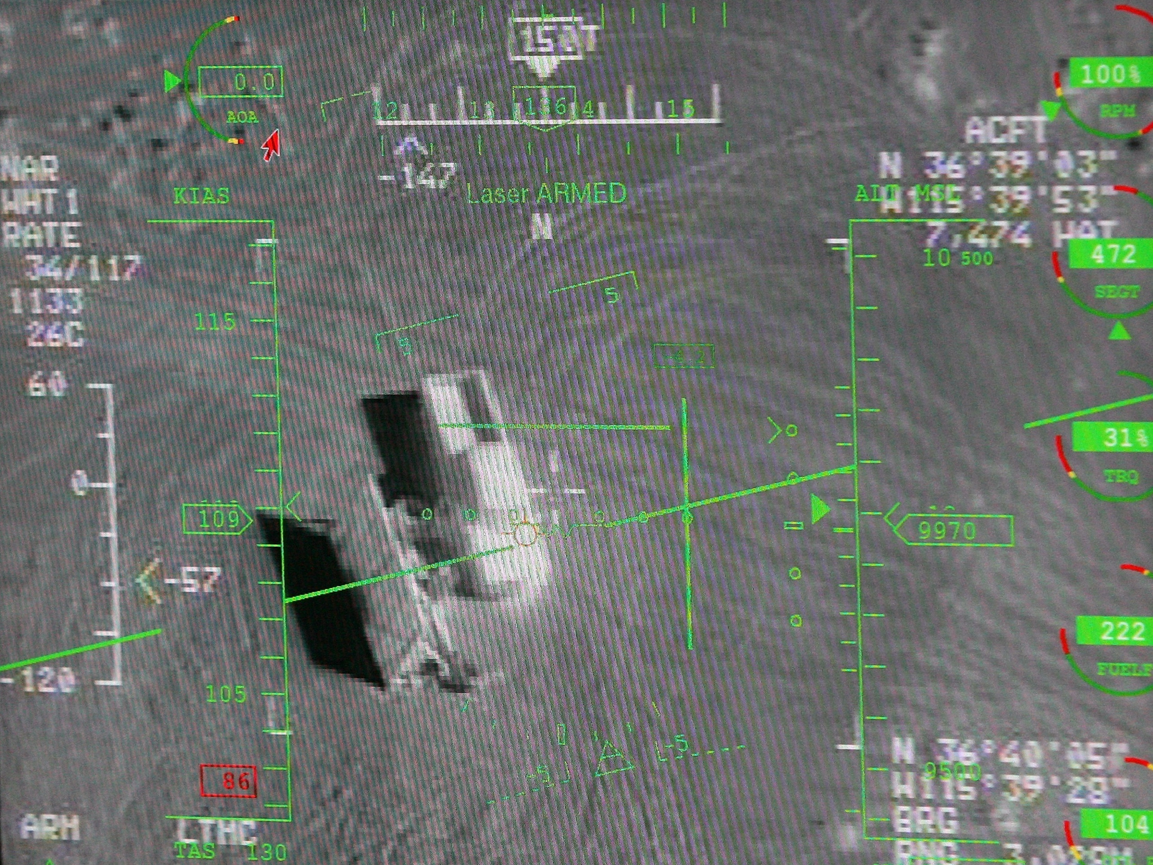 A pilot's heads up display in a ground control station shows a truck from the view of a camera on an MQ-9 Reaper during a training mission.