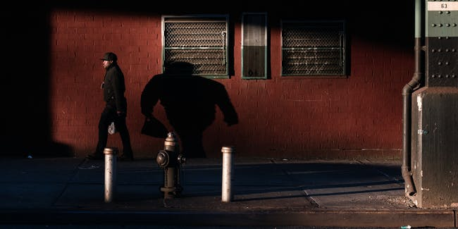 A man walks home in Brownsville, Brooklyn.