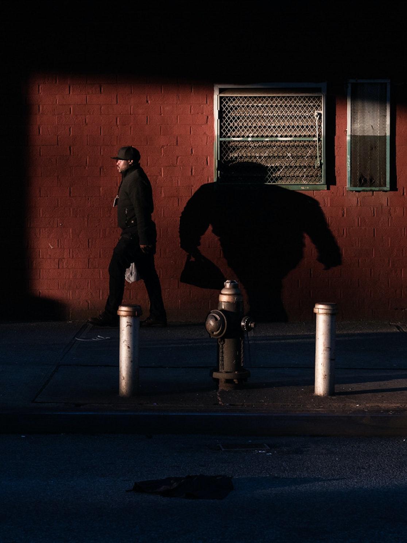 A man walks home in Brownsville, Brooklyn.