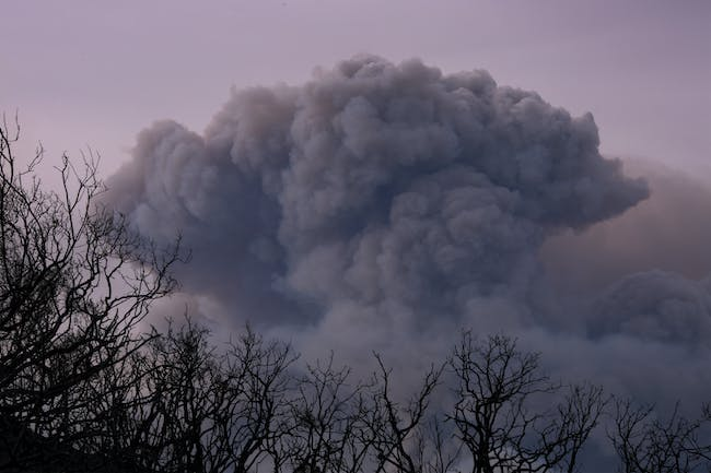 CARPINTERIA, CA - DECEMBER 10: A plume of smoke is seen from Ojai, California as the Thomas Fire grows and advances toward seaside communities on December 10, 2017 near Carpinteria, California. The Thomas Fire has grown to 173,000 acres and destroyed at least 754 structures so far. Strong Santa Ana winds have been feeding major wildfires all week, destroying houses and forcing tens of thousands of people to evacuate. (Photo by David McNew/Getty Images)