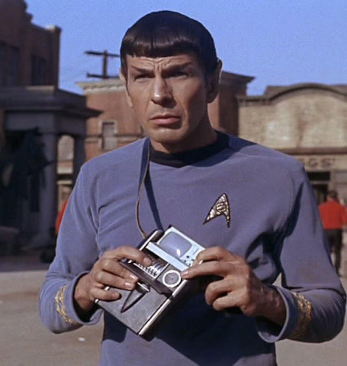 Spock holding a tricorder in the original series Star Trek.