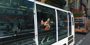 Google bus woman capture strange position Street View reflection New York City
