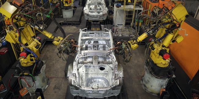 SUNDERLAND, ENGLAND - JANUARY 24:  Robotic arms assemble and weld the body shell of a Nissan car on the production line at Nissan's Sunderland plant on January 24, 2013 in Sunderland, England. The Japanese manufacturer's factory employs 6,225 people producing the Juke, Note and Qashqai models. In 2012 the Wearside facility built 510,572 cars to become the first ever UK automobile plant to have produced more than half a million cars in a year, which was 34.8 percent of the cars produced in the whole of the UK for 2012.  (Photo by Christopher Furlong/Getty Images)