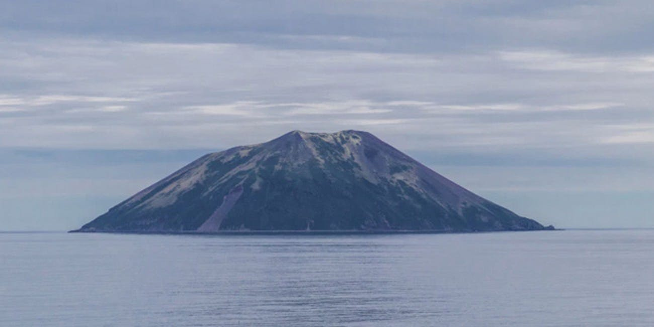 Raikoke as it normally sits, peacefully, as seen from the Sea of  Okhotsk