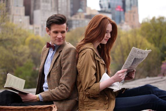 "The Doctor and Amy reading back-to-back in Central Park at the start of ""The Angels Take Manhattan."""