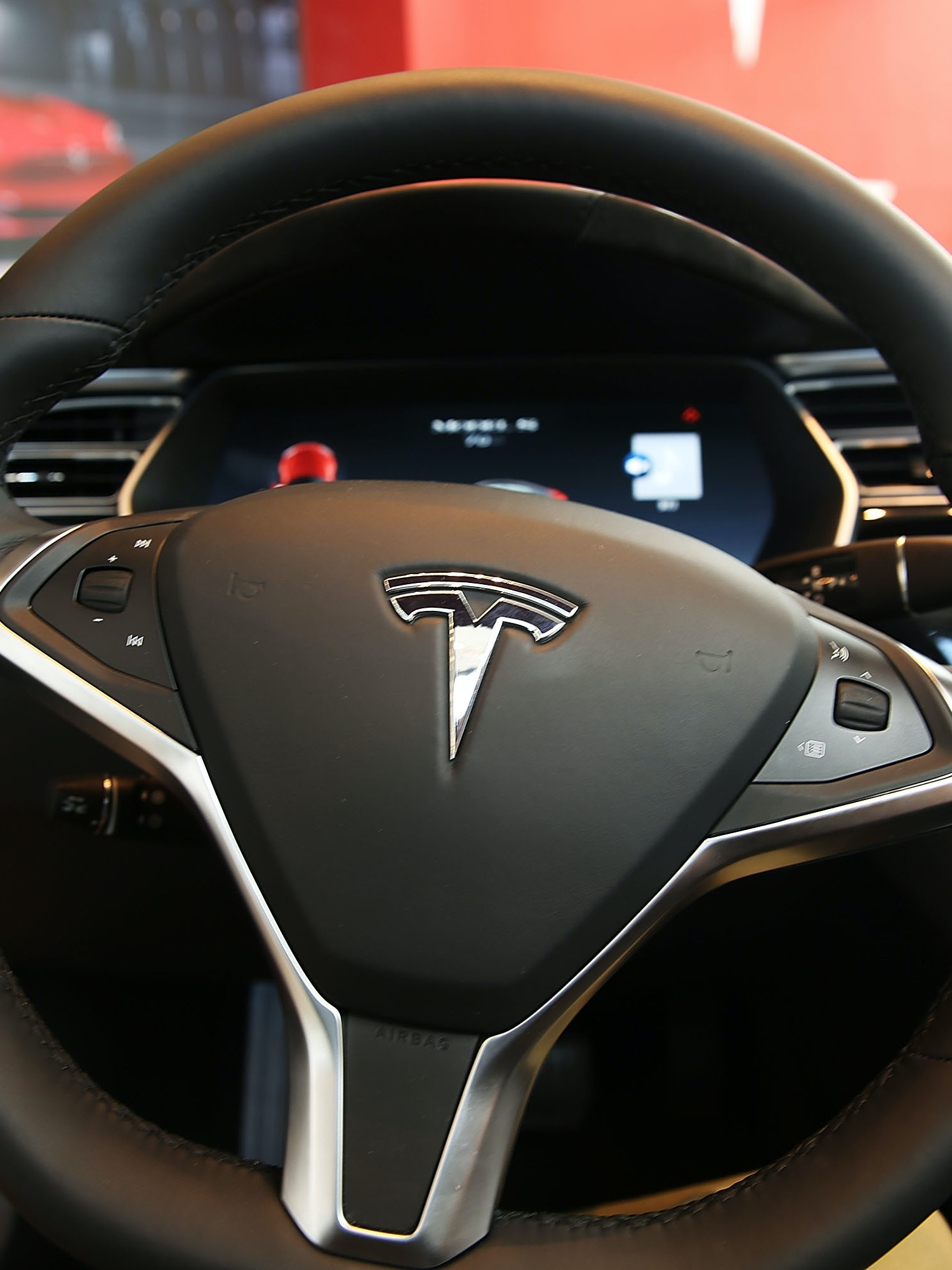 The inside of a Tesla vehicle is viewed as it sits parked in a new Tesla showroom and service center in Red Hook, Brooklyn on July 5, 2016 in New York City. The electric car company and its CEO and founder Elon Musk have come under increasing scrutiny following a crash of one of its electric cars while using the controversial autopilot service. Joshua Brown crashed and died in Florida on May 7 in a Tesla car that was operating on autopilot, which means that Brown's hands were not on the steering wheel.