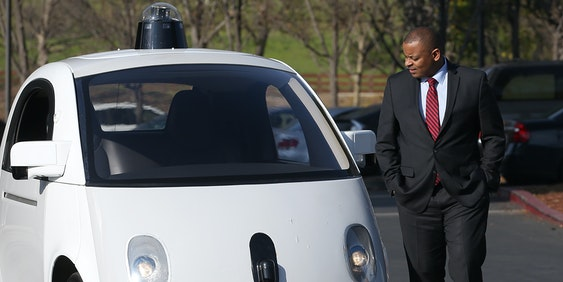 MOUNTAIN VIEW, CA - FEBRUARY 02:  U.S. Transportation Secretary Anthony Foxx inspects a Google self-driving car at the Google headquarters on February 2, 2015 in Mountain View, California.  U.S. Transportation Secretary Anthony Foxx joined Google Chairman Eric Schmidt for a fireside chat where he unveiled Beyond Traffic, a new analysis from the U.S. Department of Transportation that anticipates the trends and choices facing our transportation system over the next three decades.  (Photo by Justin Sullivan/Getty Images)