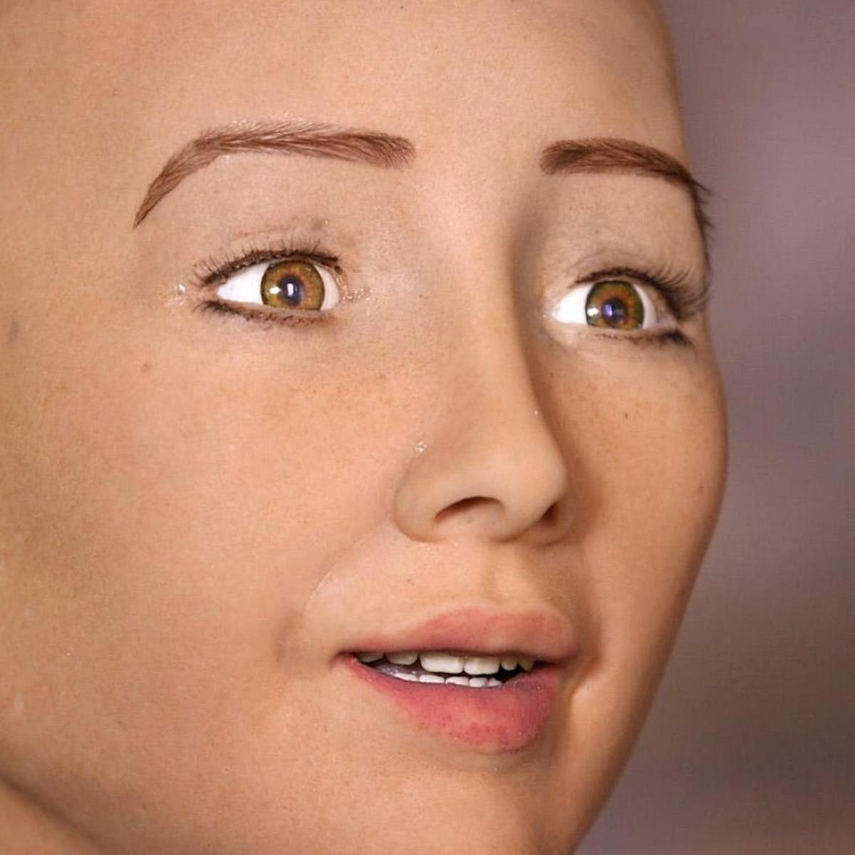 This creepy robot skin responds to being tickled, slapped, or caressed