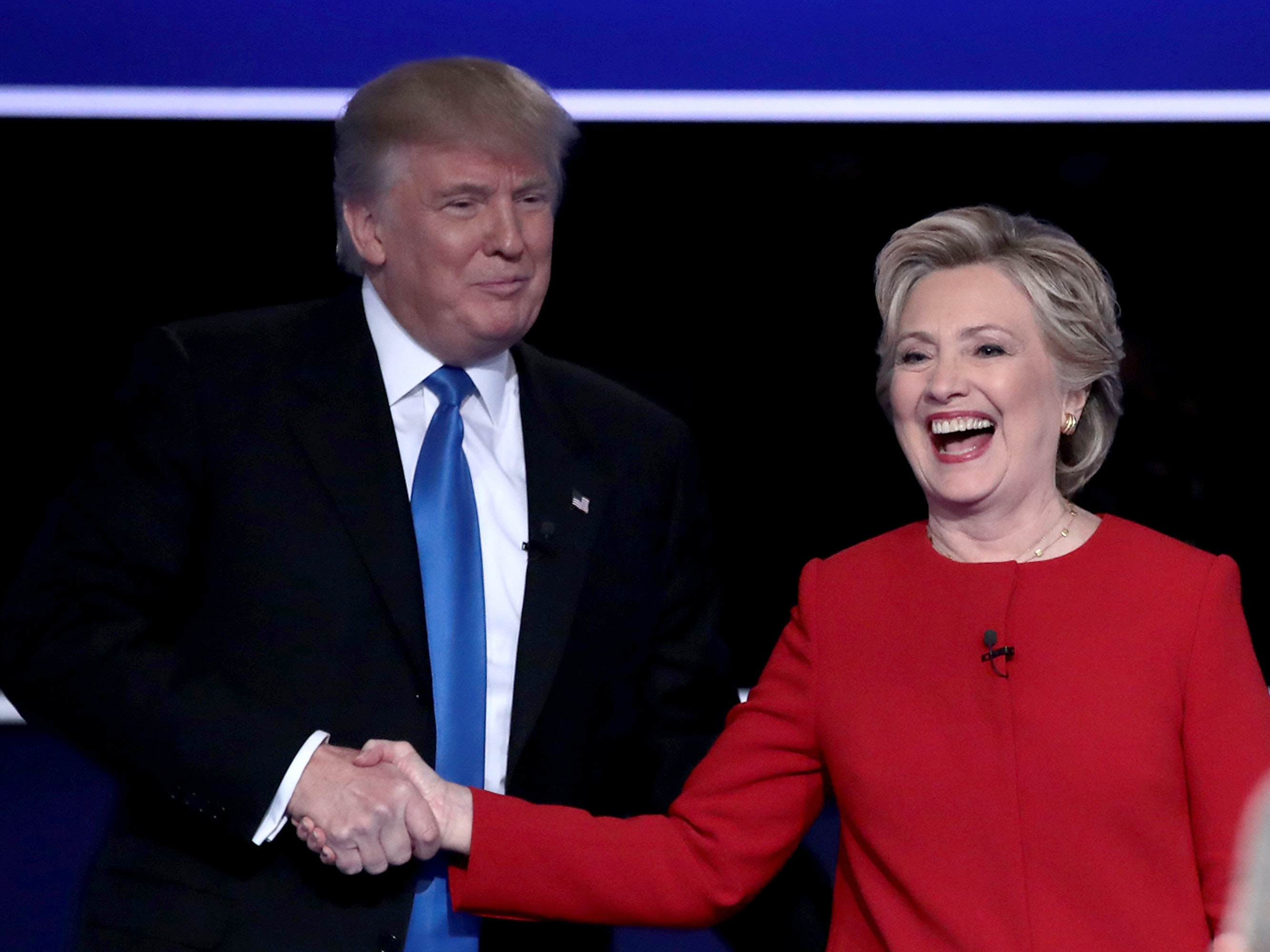 HEMPSTEAD, NY - SEPTEMBER 26:  (L-R) Republican presidential nominee Donald Trump and Democratic presidential nominee Hillary Clinton shake hands after the Presidential Debate at Hofstra University on September 26, 2016 in Hempstead, New York.  The first of four debates for the 2016 Election, three Presidential and one Vice Presidential, is moderated by NBC's Lester Holt.  (Photo by Drew Angerer/Getty Images)