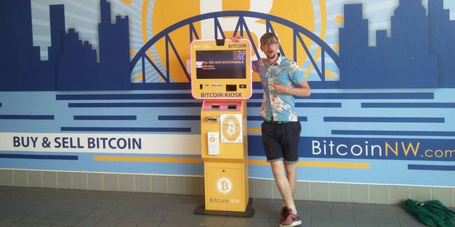 Thomas next to the Bitcoin ATM