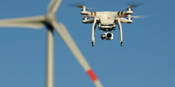 BRUECK, GERMANY - JUNE 08:  The photographer's DJI Phantom 3 Pro multirotor drone flies near a wind farm on June 8, 2016 near Brueck, Germany. Countries across Europe are debating legislation to regulate the use of consumer drones. As prices have come down and piloting simplified the market for consumer-oriented drones has risen dramatically with sales of hundreds of thousands of drones expected for coming years.  (Photo by Sean Gallup/Getty Images)