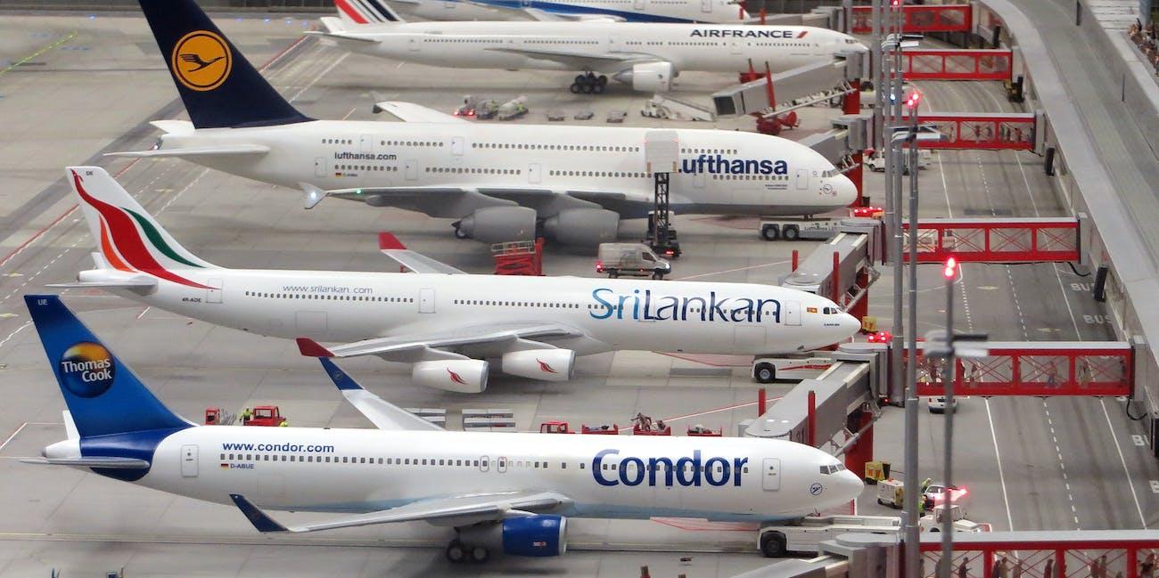 Condor Airplane on Grey Concrete Airport · Free Stock Photo