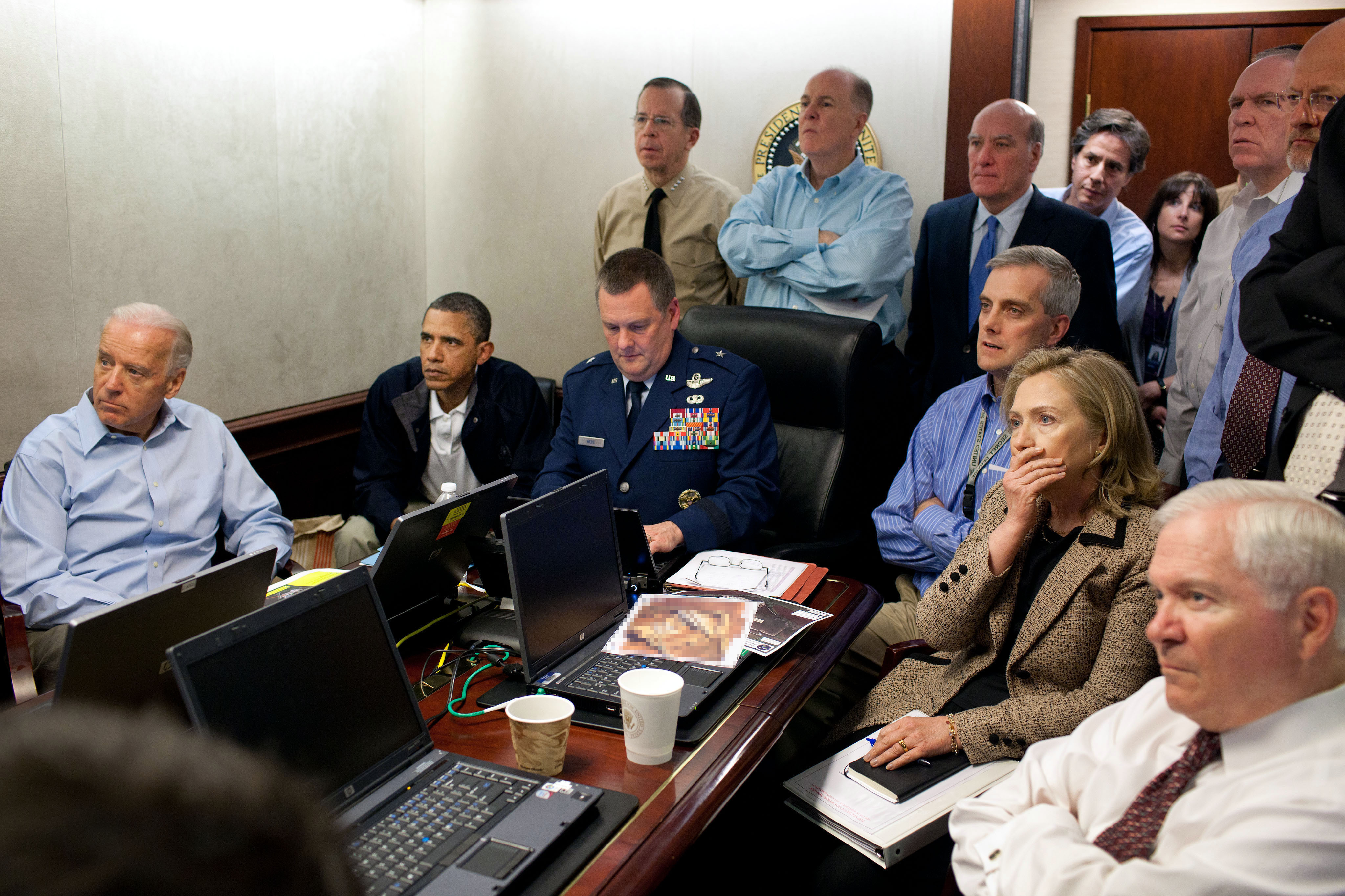President Barack Obama, Vice President Joe Biden, Secretary of State Hillary Clinton and members of the national security team receive an update on the mission against Osama bin Laden in the Situation Room of the White House May 1, 2011 in Washington, DC. Obama later announced that the United States had killed Bin Laden in an operation led by U.S. Special Forces at a compound in Abbottabad, Pakistan.