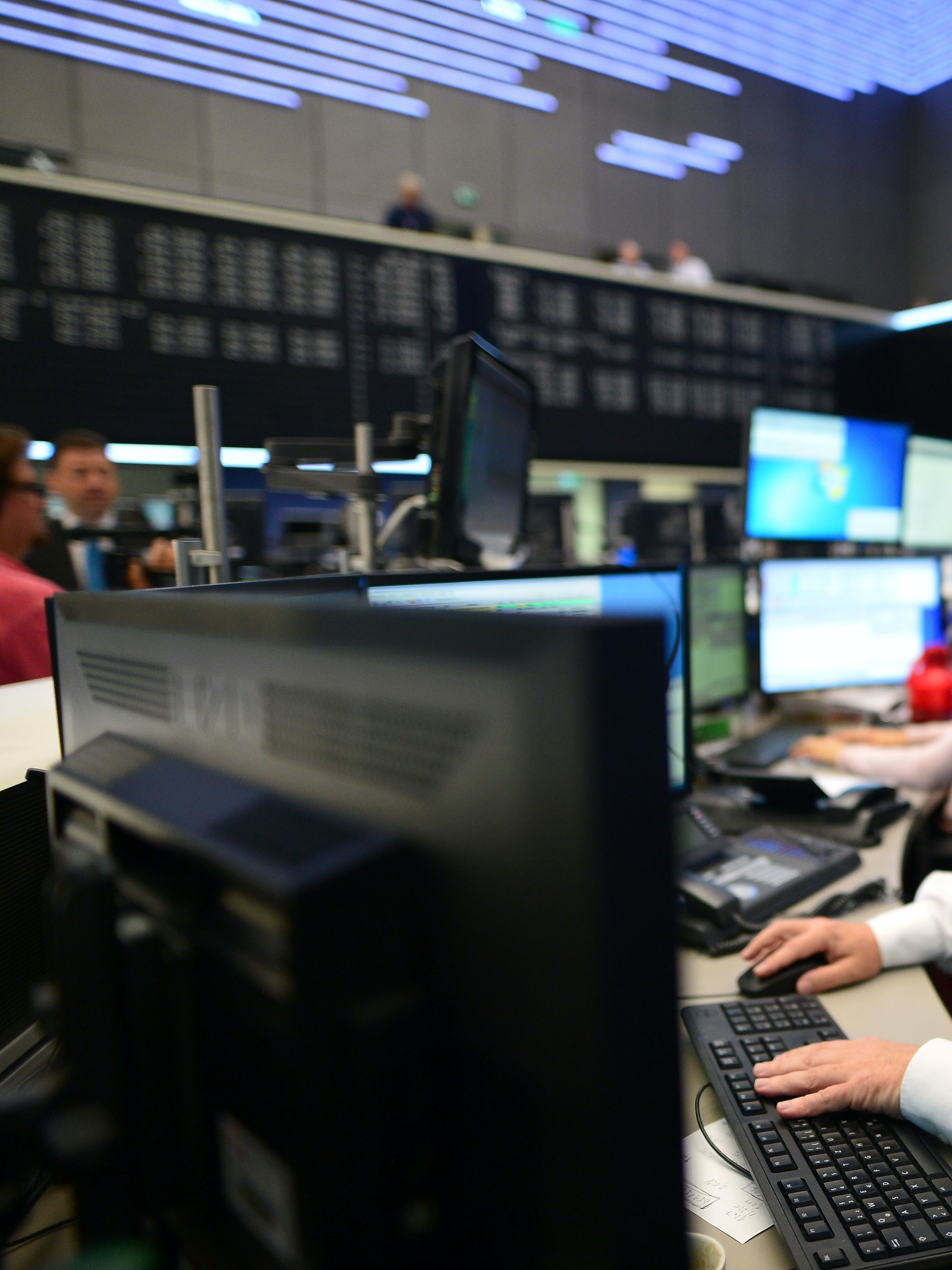 FRANKFURT AM MAIN, GERMANY - JUNE 24: A trader looks to his computer screens whilst working at the Frankfurt Stock exchange the day after a majority of the British public voted for leaving the European Union on June 24, 2016 in Frankfurt am Main, Germany. Many prominent corporate CEOs and leading economists have warned that a Brexit would have strongly negative consequences for the British economy and repercussions across Europe as well. (Photo by Thomas Lohnes/Getty Images)