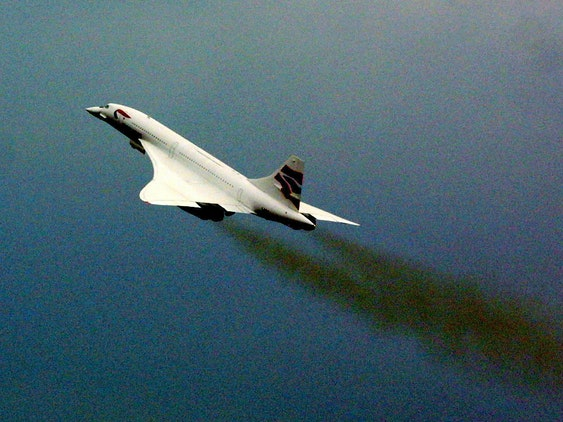 An F/A-18 in high-speed flight, with water condensation associated with shockwaves.