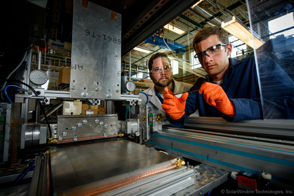Dr. Scott Hammond and Dr. Scott Mauger apply electrical-generating coatings to glass.