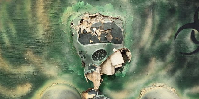 UNSPECIFIED, PERSIAN GULF REGION - JANUARY 08:  (EDITORS NOTE: Image was created with a smartphone) A gas mask hangs forms part of artwork made my military engineers and attached to a protective blast wall on January 8, 2016 at an air base in the Persian Gulf Region. The U.S. military and coalition forces use the base, located in an undisclosed location, to launch drone airstrikes against ISIL in Iraq and Syria, as well as to distribute cargo and transport troops supporting Operation Inherent Resolve.  (Photo by John Moore/Getty Images)