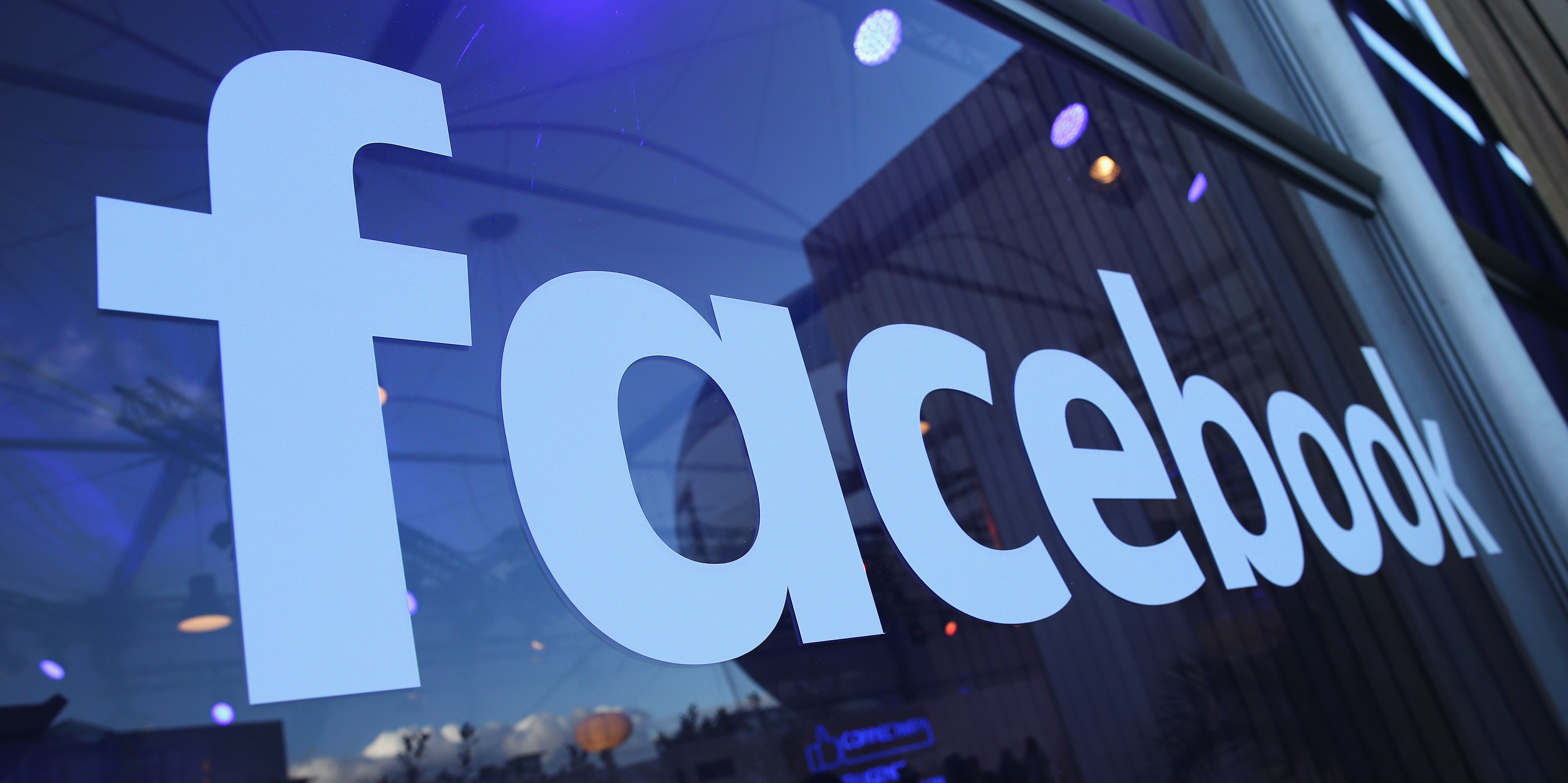 The Facebook logo is displayed at the Facebook Innovation Hub on February 24, 2016 in Berlin, Germany. The Facebook Innovation Hub is a temporary exhibition space where the company is showcasing some of its newest technologies and projects.