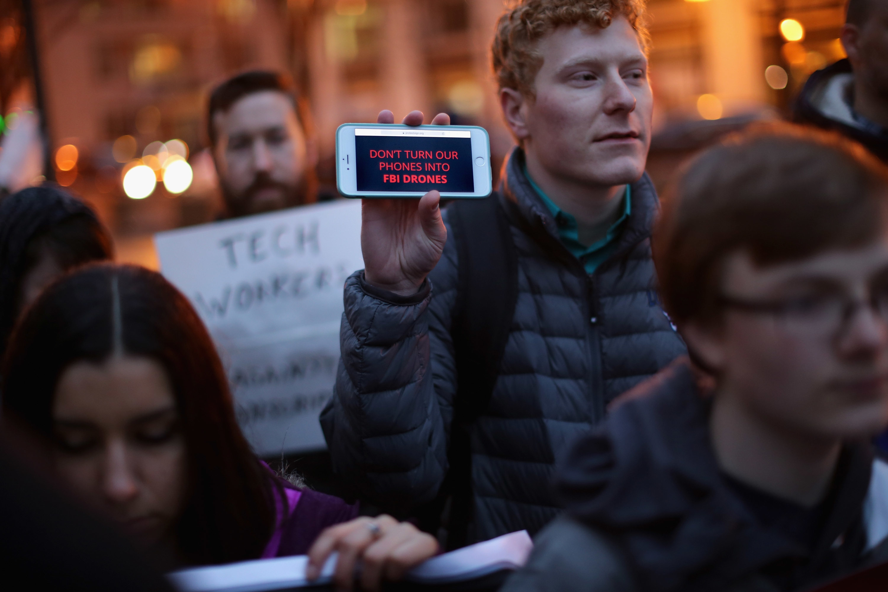 Organized by Fight for the Future, about a dozen protestors demonstrate outside the Federal Bureau of Investigation's J. Edgar Hoover headquarters in support of Apple and against a move by the federal government to force the computer company to create a 'backdoor' to the iPhone February 23, 2016 in Washington, DC.