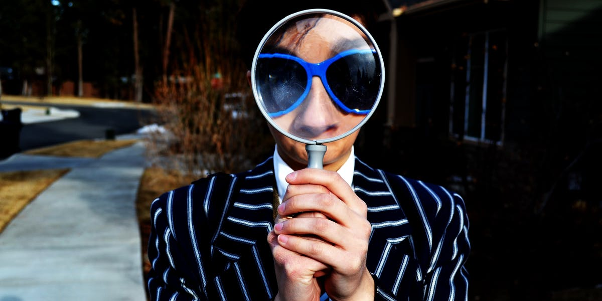gravitational wave gravity spy spies blue sunglasses pinstripe suite magnify magnifying glass